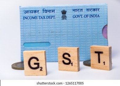 Concept of GST with indian PAN Card on isolated background