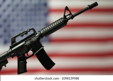 Concept for Gun Control or Gun Rights - second amendment - AR15 assault style rifle and American Flag
