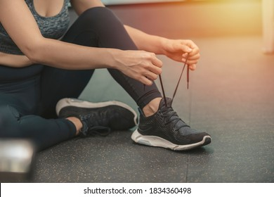 concept, gym, Sport woman tying sneakers rope. Sport center and gym concept.