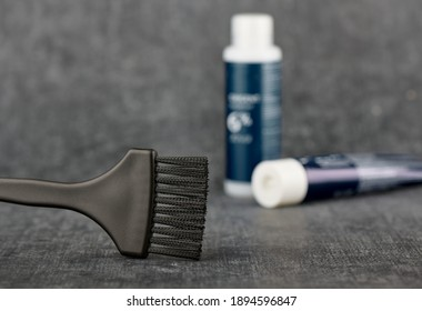 Concept is hair coloring. Brush for hair coloring, hairdresser tool, close up, stylized