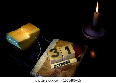 concept of halloween holiday with a pumpkin and the date no black background