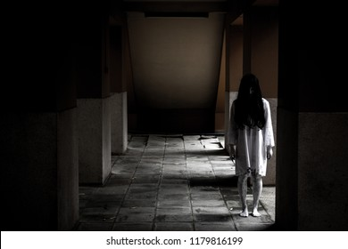 Concept of halloween with a scary women in white dress.