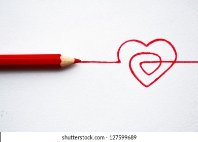 Concept hand drawn heart with pencils