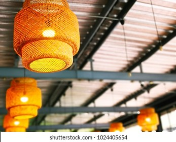 The concept of handmade natural decorations. Handmade bamboo lantern, decorated for light on the ceiling. Selective focus and copy space.