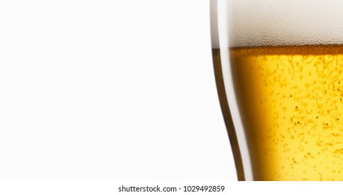 Concept of happiness and celebration. Pint of lager beer being filled in slow motion against white background for copy space.