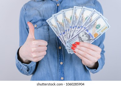 Concept of happiness, success, celebrate, excited good perfect great glad cool person in jeans shirt, satisfied customer in shop. Cropped close up portrait of nice lady with cash isolated background
