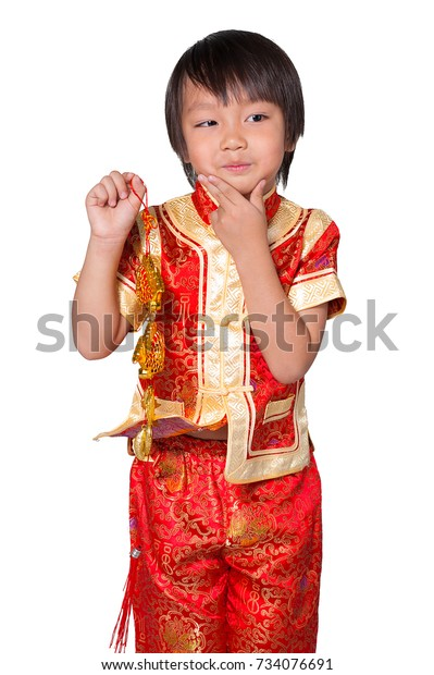 722bbc6f1 Concept Happy Chinese new year. Happy asian boy in traditional chinese  ancient dress and raising