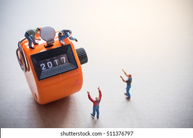 Concept of Happy New year 2017 celebration. Worker on tally counter  with digits number 2017.