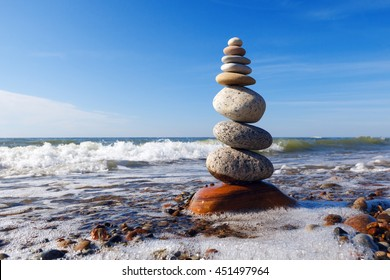 Concept of harmony and balance. Rock Zen near the sea. Balance and poise stones against the sea