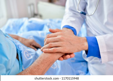Concept of healing care. The doctor is healing  old woman. The doctor is working in the hospital. Doctors encourage and treat elderly patient.