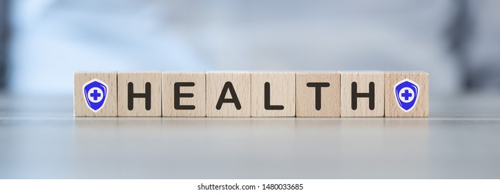 Concept of health protection on wooden cubes