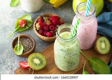 The concept of a healthy diet and diet. Green Detox mixed smoothies vegetable and fruit with organic ingredients on a stone concrete worktop.