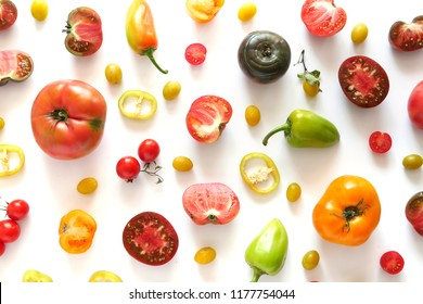 The concept of healthy eating. Pattern composition from vegetables, top view, flat lay. Food background, wallpaper. Tomatoes, pepper isolated on white background.
