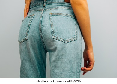 concept of healthy eating. woman in fashionable blue jeans mom. Back of a girl. hipster or vintage
