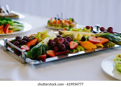The concept of healthy food, fruit, cheese and crackers on the tray