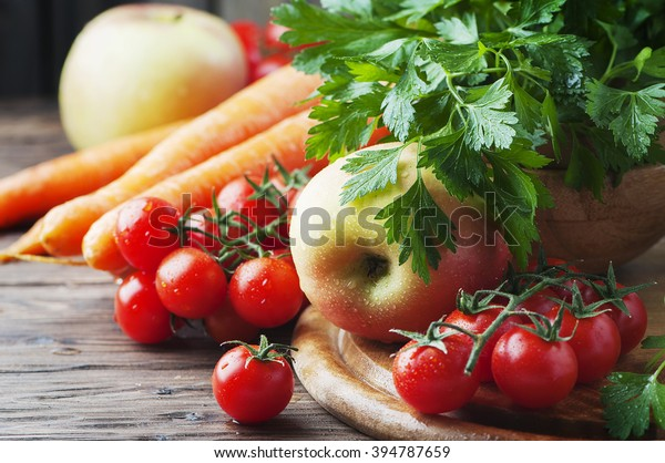 Concept of healthy food with tomato and apple, selective focus