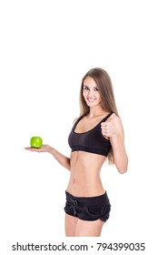 concept of a healthy lifestyle: portrait of a female fitness instructor with an Apple in his hand