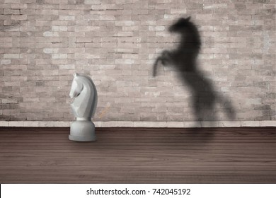 The concept of the hidden potencial.Toy horse in the room which casts a shadow on the wall.