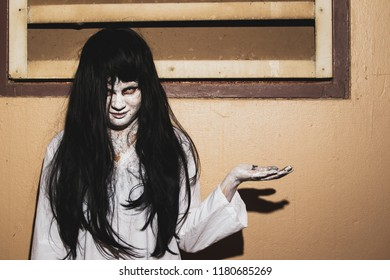 Concept of horror and holloween, women monster in white dress close up.