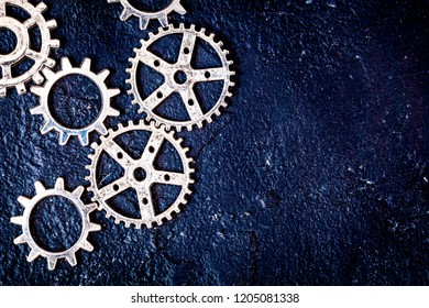 concept hour metal gears on dark background top view