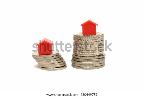 Concept of house and coin in white background.
