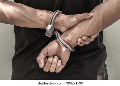 concept human trafficking, hand young man in shackle. background look old or vintage style. (vintage color tone)