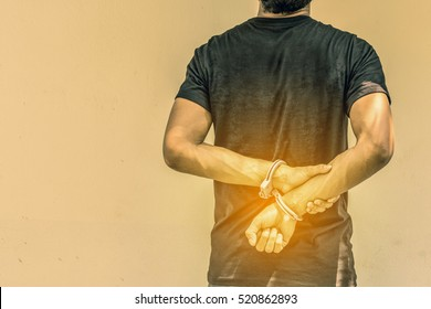 Concept human trafficking, hand young man in shackle and leave space for adding your content. background look old or vintage style. (vintage color tone)