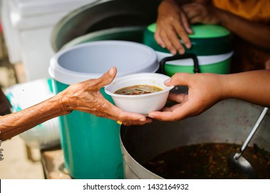 The Concept of Hunger : Food needs of the poor in society Help with Food Donation : Homeless people pick up charity food from the food donors in society : The concept of the beggar problem on earth
