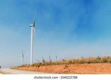 concept idea eco power energy. wind turbine on hill at thailand