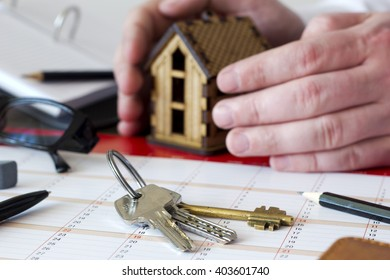 concept idea house keys and it protects man's hands