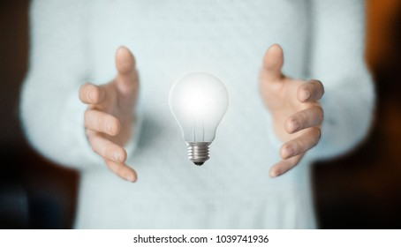 Concept of idea with lightbulb on hands