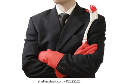 Concept to illustrate: Business man doing domestic chores. Isolated against white. Focus on utensil.