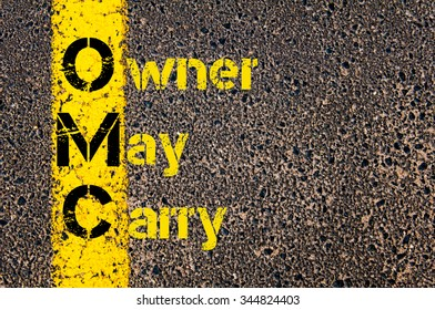 Concept image of Accounting Business Acronym OMC Owner May Carry written over road marking yellow paint line.