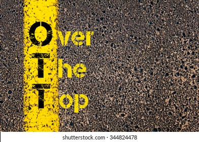 Concept image of Accounting Business Acronym OTT Over The Top written over road marking yellow paint line.