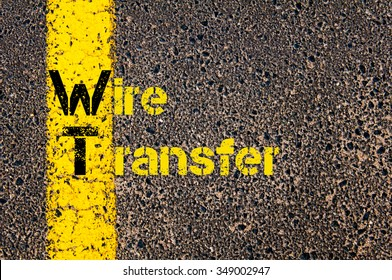Concept image of Accounting Business Acronym WT Wire Transfer written over road marking yellow paint line.