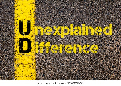 Concept image of Accounting Business Acronym UD Unexplained Difference written over road marking yellow paint line.