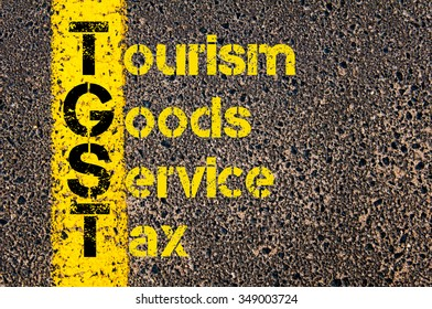 Concept image of Accounting Business Acronym TGST Tourism Goods and Service Tax written over road marking yellow paint line.