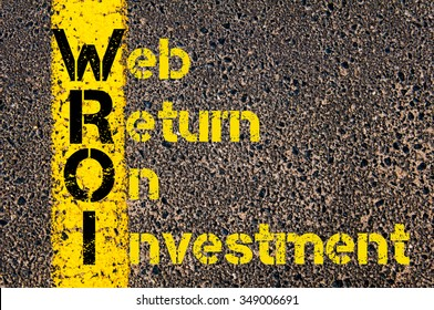 Concept image of Accounting Business Acronym WROI Web Return On Investment written over road marking yellow paint line.