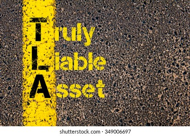 Concept image of Accounting Business Acronym TLA Truly Liable Asset written over road marking yellow paint line. - Shutterstock ID 349006697