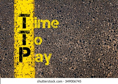 Concept image of Accounting Business Acronym TTP Time To Pay written over road marking yellow paint line.