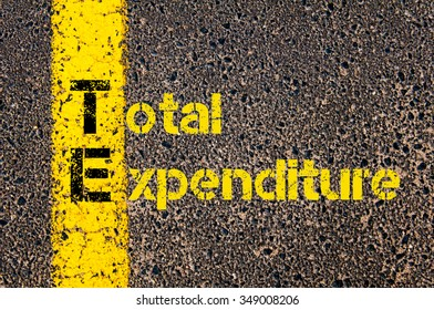 Concept image of Accounting Business Acronym TE Total Expenditure written over road marking yellow paint line.