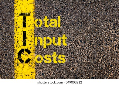 Concept image of Accounting Business Acronym TIC Total Input Costs written over road marking yellow paint line.