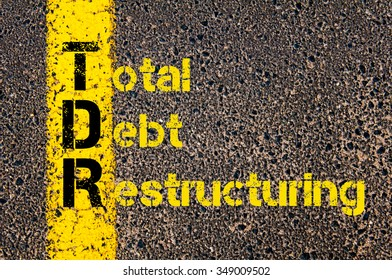 Concept image of Accounting Business Acronym TDR Total Debt Restructuring written over road marking yellow paint line.