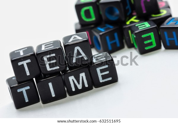 concept image of alphabet's cube and word - Tea time with isolated white background/selective focus