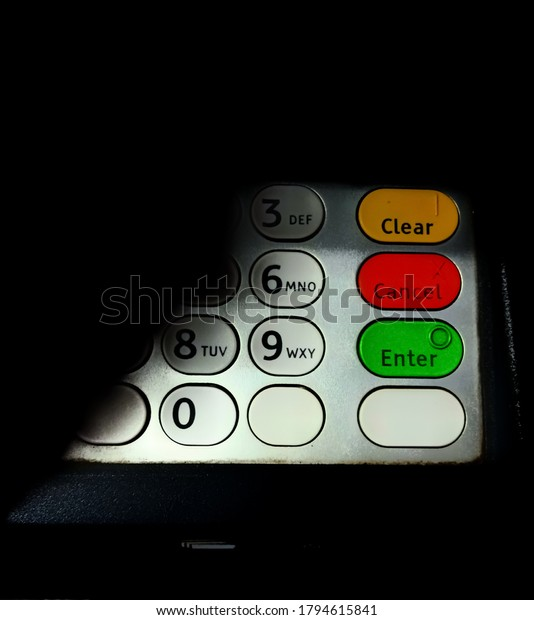 concept image for atm frauds and atm skimming/old rustic keypad of an   atm machine that has not been maintained properly