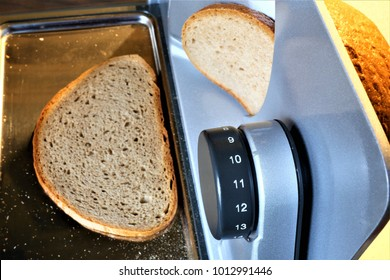 An concept Image of a bread slicer, cutter with bread