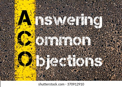 Concept image of Business Acronym ACO Answering Common Objections written over road marking yellow paint line.