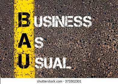 Concept image of Business Acronym BAU Business As Usual written over road marking yellow paint line