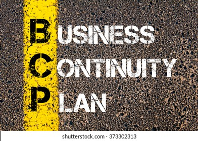 Concept image of Business Acronym BCP Business Continuity Plan written over road marking yellow paint line
