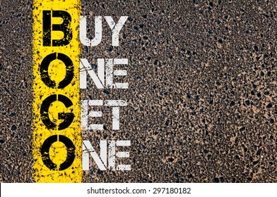 Concept image of Business Acronym BOGO as Buy One Get One  written over road marking yellow paint line.